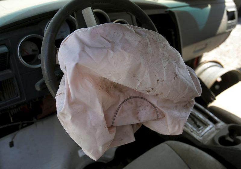 A deployed Takata manufactured airbag is seen on the driver's side of a 2007 Dodge Charger at a recycled auto parts lot in Detroit, Michigan