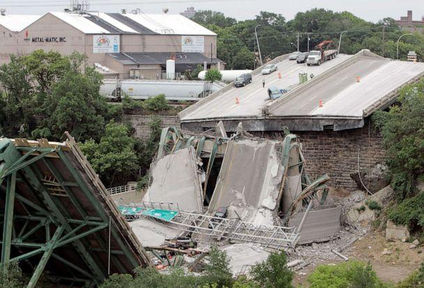PHOTO: Vehicles are strewn amongst the wreckage of Interstate 35W bridge, Aug. 5, 2007. (M. Spencer Green/AP, FILE)