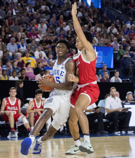 Duke's R.J. Barrett, left drives to the basket as McGill Redmen's Isaiah Cummins defends during first half exhibition basketball action in Laval, Quebec, Sunday, Aug. 19, 2018. (Graham Hughes/The Canadian Press via AP)