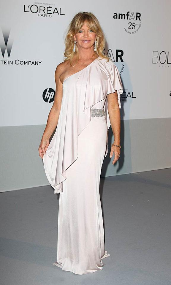 "Also on hand at the star-studded amfAR event was the always adorable Goldie Hawn, who looked incredibly chic in a fabulously ruffled, one-shoulder Cavalli frock and diamond-and-pearl earrings. Mike Marsland/<a href=""http://www.wireimage.com"" target=""new"">WireImage.com</a> - May 19, 2011"