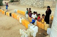 Displaced children from Hodeidah province wait for water supplies in a camp in the northern district of Abs in Yemen's northwestern Hajjah province on November 10, 2018
