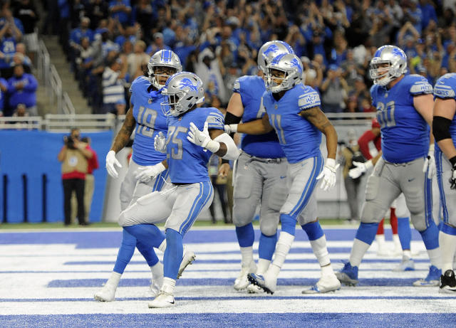 Lions players celebrate a touchdown during their Week 1 win over the Arizona Cardinals. (AP)