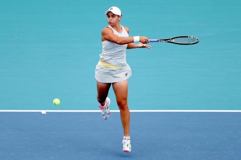 Ashleigh Barty bludgeons a forehand en route to retaining her Miami Open title with victory over Bianca Andreescu
