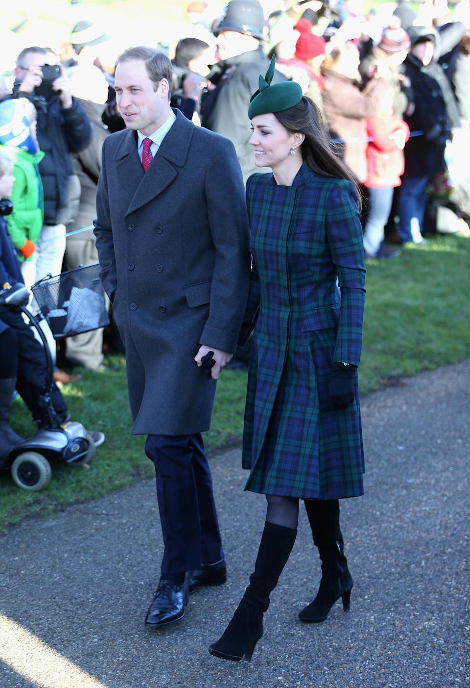 <p>New mum Kate wore a green tartan coat from Alexander McQueen's diffusion line McQ with her Aquatalia 'Rhumba' boots for the later church service in 2013. She accessorised with a green Gina Foster hat. (Getty) </p>