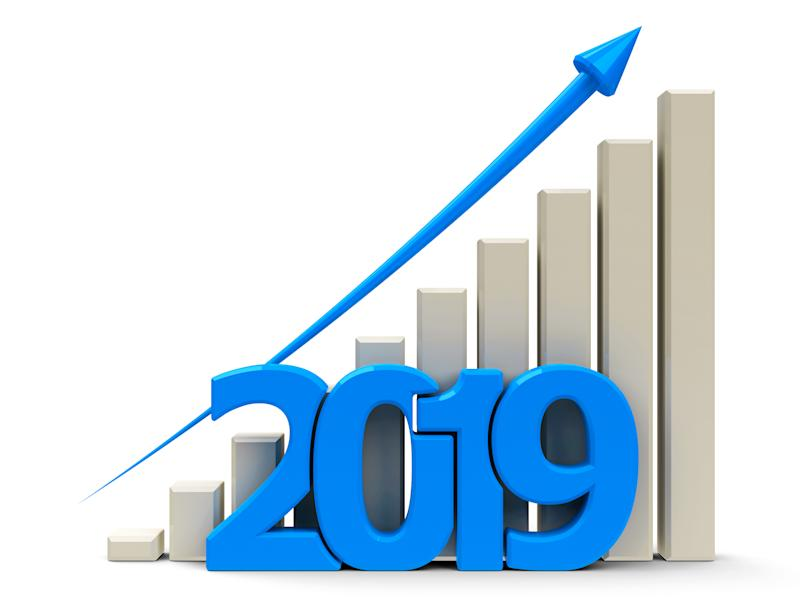 Bar chart with blue line trending up and 2019 in front of the chart.