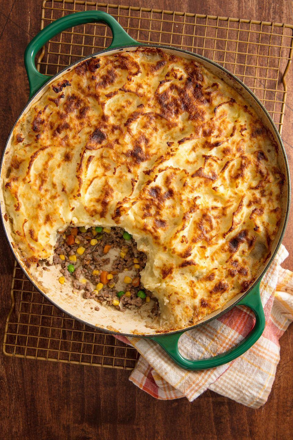 """<p>Cottage pie is essentially a shepherd's pie but with beef. It's a meat pie, filled with minced beef and topped with mashed potatoes. YUM. The sauce we use is super simple. </p><p>Get the <a href=""""https://www.delish.com/uk/cooking/recipes/a29139632/cottage-pie/"""" rel=""""nofollow noopener"""" target=""""_blank"""" data-ylk=""""slk:Cottage Pie"""" class=""""link rapid-noclick-resp"""">Cottage Pie</a> recipe. </p>"""