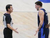 Dallas Mavericks guard Luka Doncic (77) questions referee Mark Ayotte after being called for an offensive foul and a technical foul during the first half of the team's NBA basketball game against the San Antonio Spurs, Wednesday, March 10, 2021, in Dallas. (AP Photo/Brandon Wade)