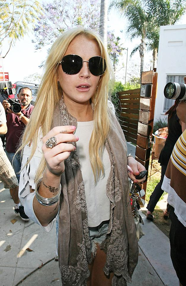 "The travails of Lindsay Lohan continued this week when her court-mandated SCRAM alcohol monitoring anklet was set off at an MTV after party Sunday night. The judge upped LiLo's bail to $200,000, which required the troubled star to produce another $10,000 as security. Pretty steep price to pay for a drink, Lindsay! <a href=""http://www.infdaily.com"" target=""new"">INFDaily.com</a> - June 9, 2010"