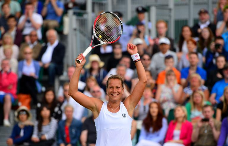 Czech Republic's Barbora Zahlavova Strycova celebrates winning her women's singles fourth round match against Denmark's Caroline Wozniacki on day seven of the 2014 Wimbledon Championships in southwest London on June 30, 2014