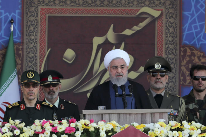 President Hassan Rouhani speaks at a military parade marking 39th anniversary of outset of Iran-Iraq war, in front of the shrine of the late revolutionary founder Ayatollah Khomeini, just outside Tehran, Iran, Sept. 22, 2019. (Iranian Presidency Office via AP)