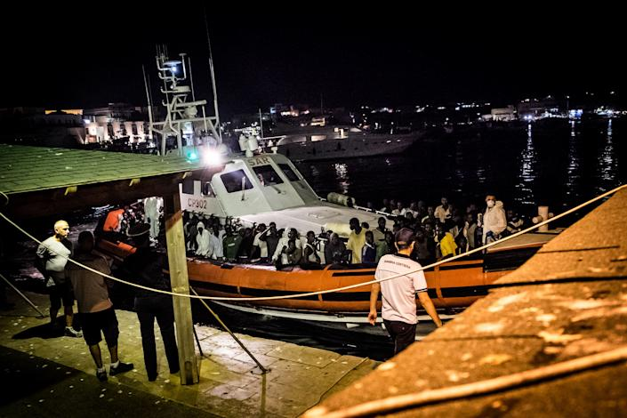 Lampedusa (italy), midnight between august 27h and 28th. Migrants rescued by the Italian Coast Guard disembark at the Favarolo peer. (Photo by Marco Panzetti/NurPhoto via Getty Images)