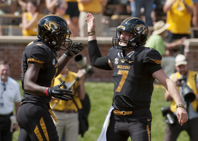 Missouri quarterback Maty Mauk, right, celebrates with teammate Darius White, left, after White scored on a 44-yard reception during the first quarter of an NCAA college football game against South Dakota State Saturday, Aug. 30, 2014, in Columbia, Mo. (AP Photo/L.G. Patterson)