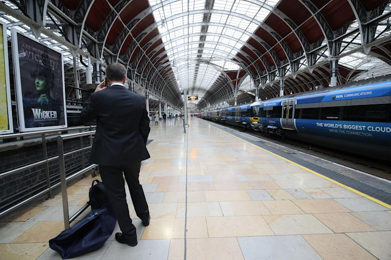 "Travellers at Paddington Station, London as trains are unable to run between the railway hub and Slough or Heathrow Airport after overhead electric wires were ""severely"" damaged at Ealing on Tuesday night. (Photo by Yui Mok/PA Images via Getty Images)"