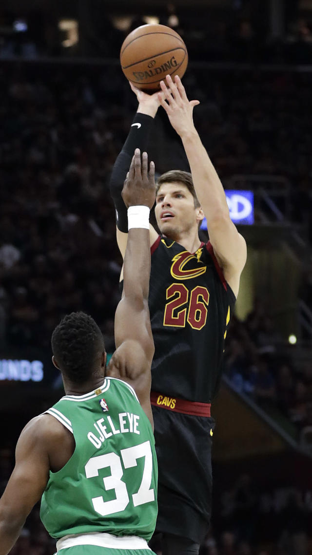 Cleveland Cavaliers' Kyle Korver (26) shoots over Boston Celtics' Semi Ojeleye (37) in the first half of Game 4 of the NBA basketball Eastern Conference finals, Monday, May 21, 2018, in Cleveland. (AP Photo/Tony Dejak)