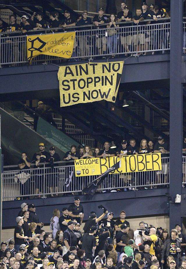 Banners supporting the Pittsburgh Pirates hang from the left field rotunda as the Pirates play the Cincinnati Reds in the NL wild-card playoff baseball game Tuesday, Oct. 1, 2013, in Pittsburgh. (AP Photo/Don Wright)