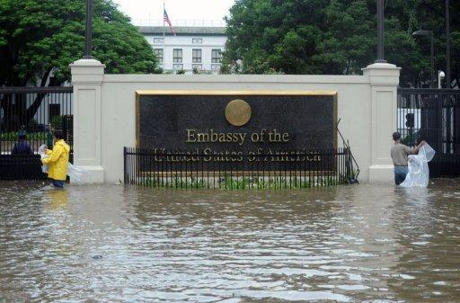 The flooded entrance to the US embassy in Manila on August 1, 2012. Flooding brought on by Typhoon Saola forced the embassy to close for the day