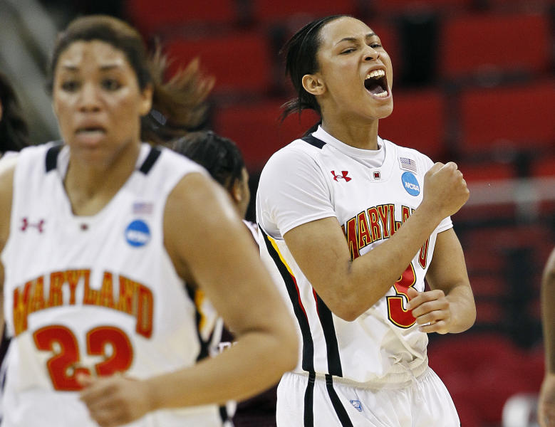 Maryland's Brene Moseley, right, reacts following a basket against Texas A&M during the second half of an NCAA college women's tournament regional semifinal basketball game in Raleigh, N.C., Sunday, March 25, 2012. Maryland won 81-74. Maryland's Kim Rodgers (22) runs on the court. (AP Photo/Gerry Broome)