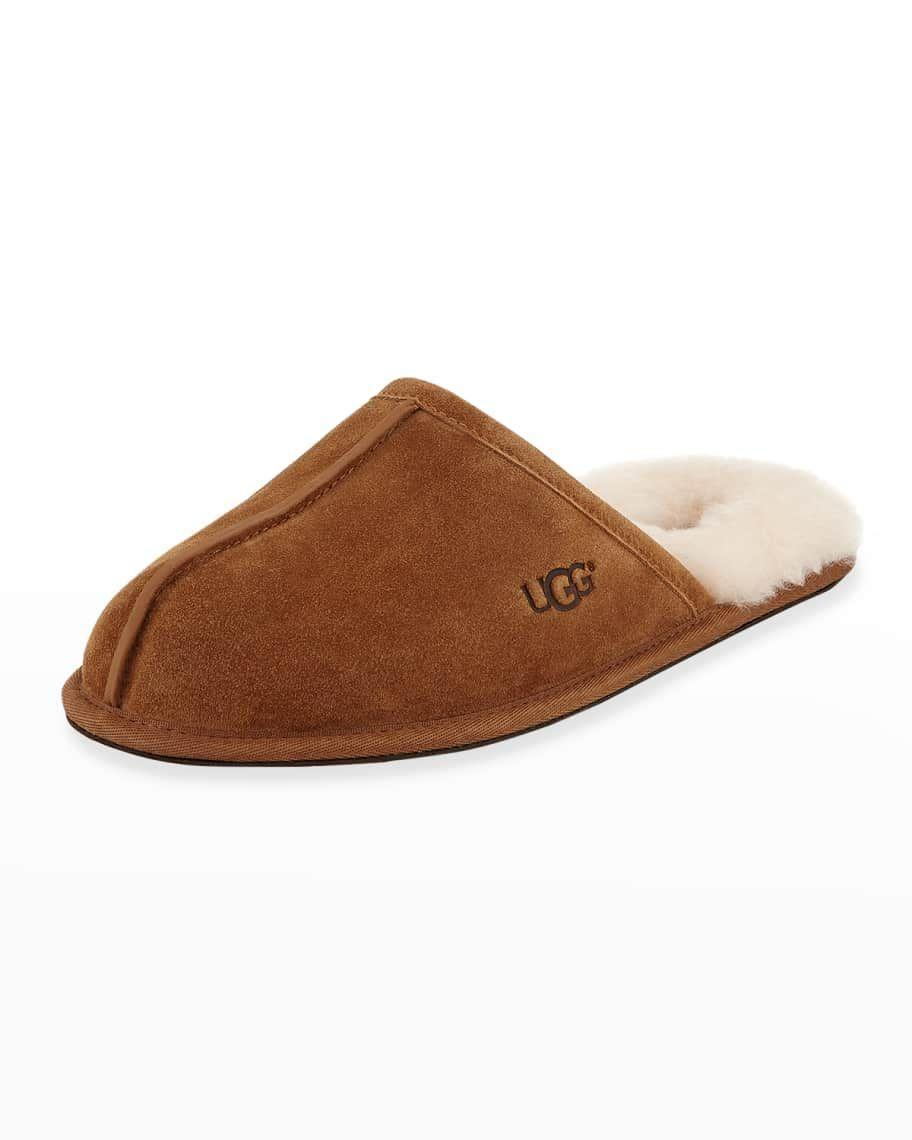 """<p><strong>UGG</strong></p><p>saksfifthavenue.com</p><p><strong>$80.00</strong></p><p><a href=""""https://go.redirectingat.com?id=74968X1596630&url=https%3A%2F%2Fwww.saksfifthavenue.com%2Fproduct%2Fugg-men-s-scuff-fur-lined-mule-slippers-0400099018801.html&sref=https%3A%2F%2Fwww.womansday.com%2Flife%2Fg964%2Fgifts-for-men%2F"""" rel=""""nofollow noopener"""" target=""""_blank"""" data-ylk=""""slk:Shop Now"""" class=""""link rapid-noclick-resp"""">Shop Now</a></p><p>No man can resist the comfort and softness of these fur-lined suede slippers, complete with wool lining and a sheepskin insole. </p>"""