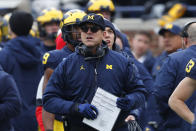 FILE - In this Nov. 30, 2019, file photo, Michigan head coach Jim Harbaugh watches against Ohio State during an NCAA college football game in Ann Arbor, Mich. Harbaugh is happy to still be coaching at Michigan for a seventh season, a year after winning two games and signing a new contract that gives the school an out if it wants to replace him. (AP Photo/Paul Sancya, File)