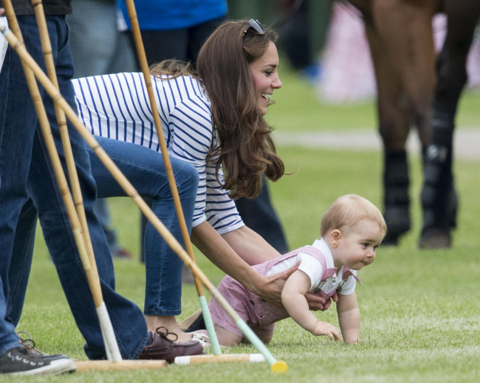 <p>The Duchess of Cambridge was running around after a little Prince George a the Jerudong Park Trophy at Cirencester Park Polo Club in 2014. (Mark Cuthbert/UK Press via Getty Images)</p>