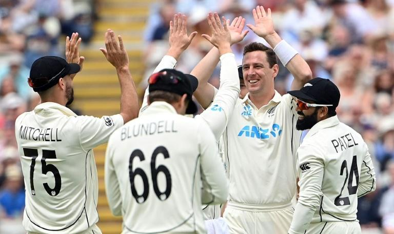 Player of the match - New Zealand's Matt Henry (2R) celebrates dismissing England's Dom Sibley on the first day of the second Test at Edgbaston