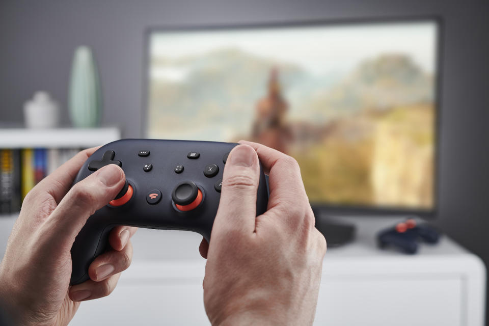 Detail of hands holding a Google Stadia video game controller, taken on November 27, 2019. (Photo by Olly Curtis/Future Publishing via Getty Images)
