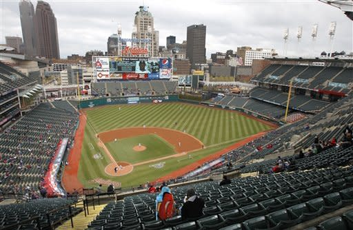 With game time temperatures in the low 40's and feeling like the mid-30's, few fans sits on the seats as the Cleveland Indians take on the Chicago White Sox in the first inning a baseball game in Cleveland on Wednesday, April 11, 2012. (AP Photo/Amy Sancetta)