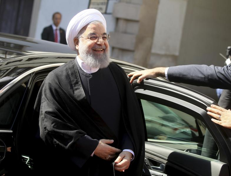 Iranian President Hassan Rouhani arrives for a military welcome ceremony with Austrian President Alexander Van Der Bellen as part of a meeting in Vienna, Austria, Wednesday, July 4, 2018. (AP Photo/Ronald Zak)
