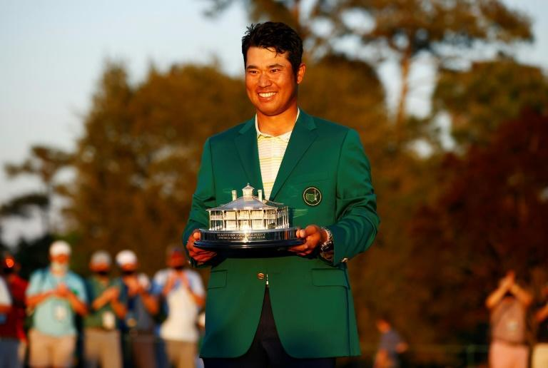 Hideki Matsuyama with the Masters Trophy during the victory ceremony after becoming the first Japanese man to win a golf major