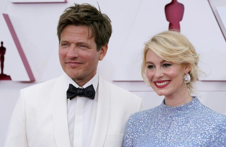"""Danish film director Thomas Vinterberg (L) -- seen with his actress wife Helene Reingaard Neumann on the Oscars red carpet -- dedicated his win for """"Another Round"""" to his late daughter"""