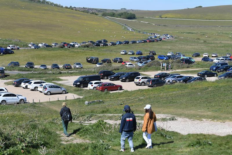 Birling Gap car park is overflowing Eastbourne, England. Parts of the country were expected to reach 29 degrees celsius, luring sunbathers and testing the capacity of parks and beaches to accommodate social distanced crowds. (Photo by Mike Hewitt/Getty Images)