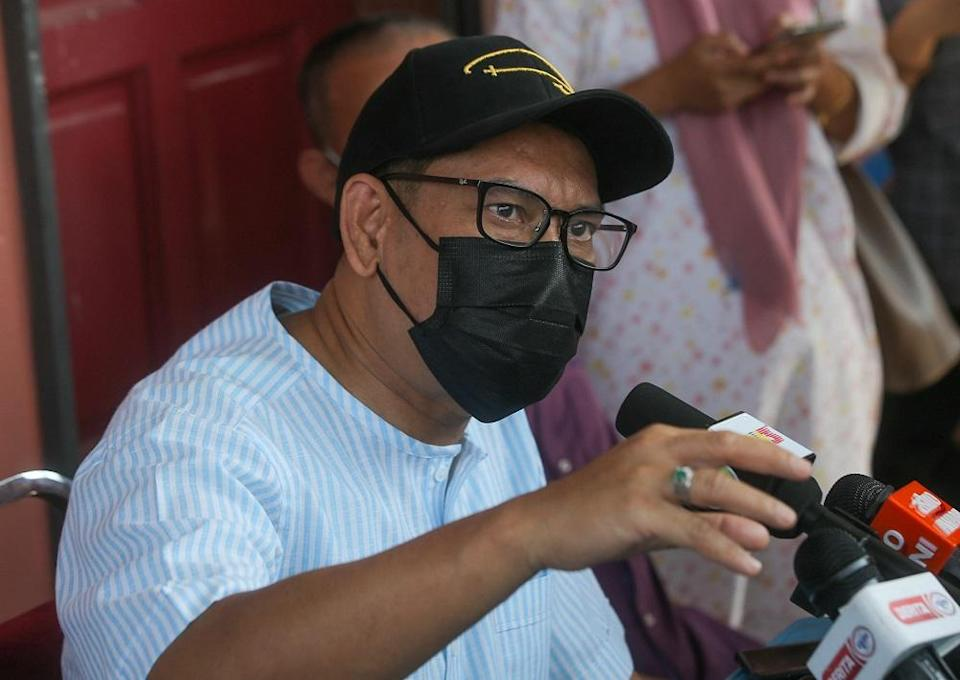 Datuk Seri Ahmad Faizal Azumu speaks to reporters after a visit to the vaccination centre in Chenderiang, Tapah. – Picture by Farhan Najib