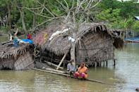 Indian and Bangladeshi officials said at least 36 villages had been flooded by a storm surge