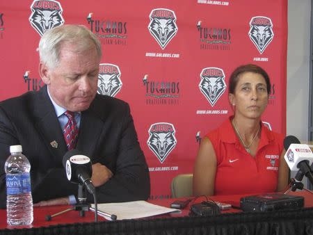 Paul Krebs and Women's head soccer coach Kit Vela speak to reporters during a news conference in Albuquerque