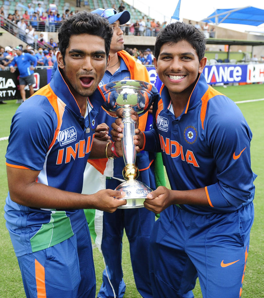 TOWNSVILLE, AUSTRALIA - AUGUST 26:  Vijay Zol (L) and Akhil Herwadkar of India celebrate with the trophy after winning  the 2012 ICC U19 Cricket World Cup Final between Australia and India at Tony Ireland Stadium on August 26, 2012 in Townsville, Australia.  (Photo by Ian Hitchcock-ICC/Getty Images)
