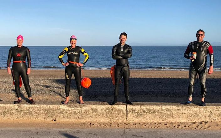 Adam Diver, pictured here by the sea, where he has been swimming now that the pool is temporarily closed