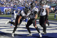 Atlanta Falcons tight end Lee Smith (85) celebrates with his teammates after catching a touchdown pass during the second half of an NFL football game against the New York Giants, Sunday, Sept. 26, 2021, in East Rutherford, N.J. (AP Photo/Bill Kostroun)