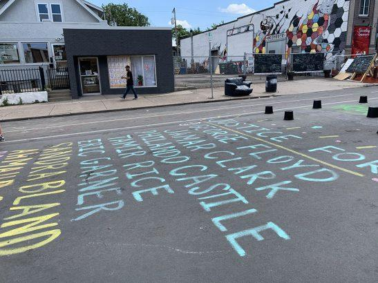 The names of Black people who died in police custody line the street at the intersection where George Floyd was murdered in Minneapolis. (Beth Hawkins)