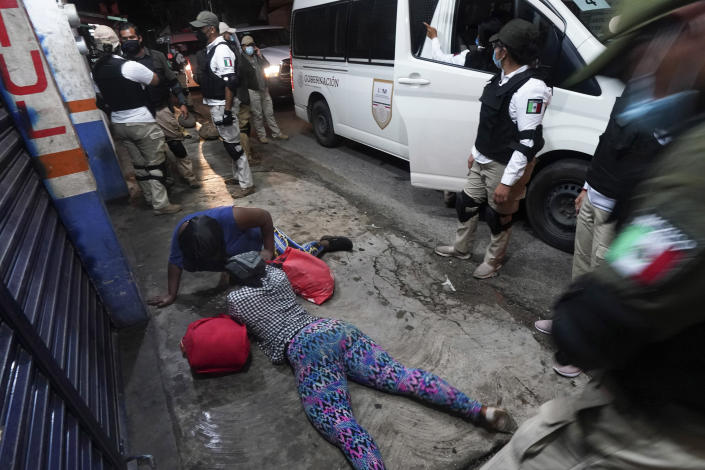 Mexican immigration agents detain a Haitian migrant who is part of a migrant caravan heading north in Huixtla, Chiapas state, Mexico, Sunday, Sept. 5, 2021. (AP Photo/Marco Ugarte)