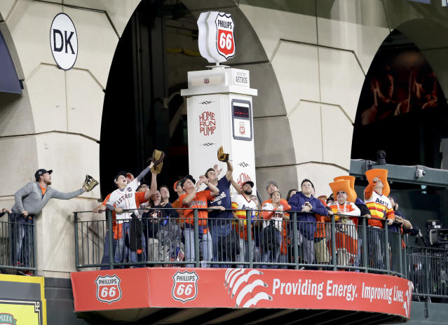 Fans wait for fly balls during batting practice before Game 4 of a baseball American League Championship Series between the Houston Astros and the Boston Red Sox on Wednesday, Oct. 17, 2018, in Houston. (AP Photo/Lynne Sladky)