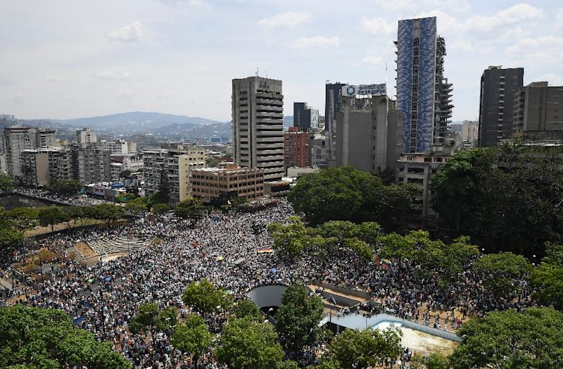 Anti-government demonstrators rally in Caracas ahead of what opposition leader Juan Guaido said would be staggered industrial action leading to a general strike (AFP Photo/Federico PARRA)