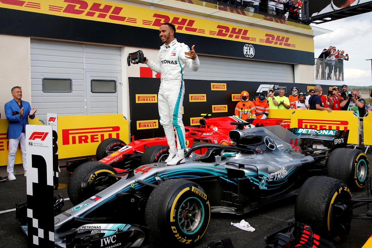 Formula One F1 - French Grand Prix - Circuit Paul Ricard, Le Castellet, France - June 24, 2018   Mercedes' Lewis Hamilton celebrates on his car after winning the race   REUTERS/Jean-Paul Pelissier     TPX IMAGES OF THE DAY