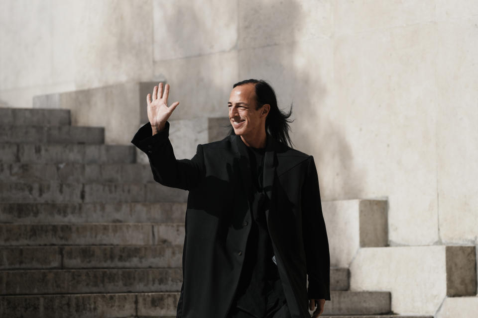 Fashion designer Rick Owens acknowledges applauses after the presentation of his Spring-Summer 2022 ready-to-wear fashion show Thursday, Sept. 30, 2021, in Paris. (AP Photo/Thibault Camus)