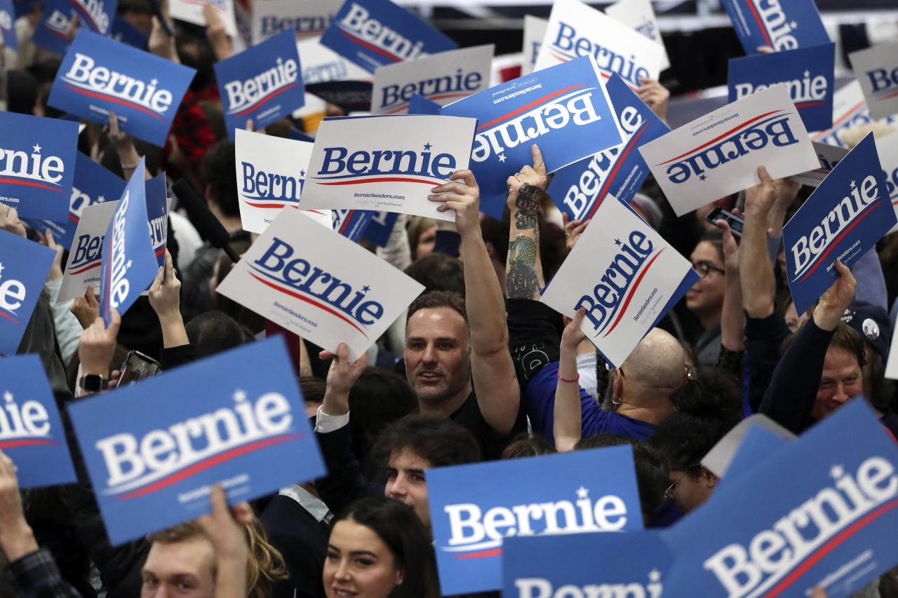 Supporters of Democratic presidential candidate Sen. Bernie Sanders, I-Vt., during a primary night election rally in Essex Junction, Vt., Tuesday, March 3, 2020. (AP Photo/Charles Krupa)