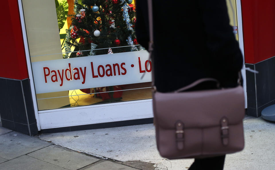 """A payday loans sign is seen in the window of Speedy Cash in northwest London November 25, 2013. Britain is to cap the cost of payday loans, stepping up its controls over the industry only a month after the regulator said that enforced price controls would be """"a very intrusive proposition"""". REUTERS/Suzanne Plunkett (BUSINESS POLITICS SOCIETY)"""