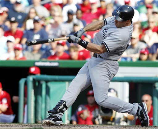 New York Yankees' Mark Teixeira swings on a two-run double during the 14th inning of a baseball game against the Washington Nationals at Nationals Park on Saturday, June 16, 2012, in Washington. The Yankees won 5-3 in 14 innings. (AP Photo/Alex Brandon)