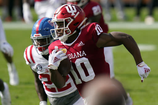 Indiana running back David Ellis (10) runs away from Mississippi defensive lineman Tariqious Tisdale during the first half of the Outback Bowl NCAA college football game Saturday, Jan. 2, 2021, in Tampa, Fla. (AP Photo/Chris O'Meara)