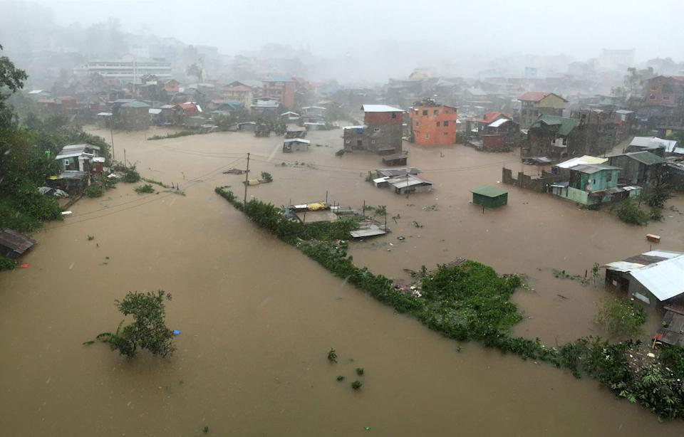 FILE PHOTO: Houses, partially submerged in floods waters caused by heavy rains brought by Typhoon Lando (international name Koppu), are seen in City Camp Lagoon at Baguio city, on October 19, 2015. (Source: REUTERS/Harley Palangchao)