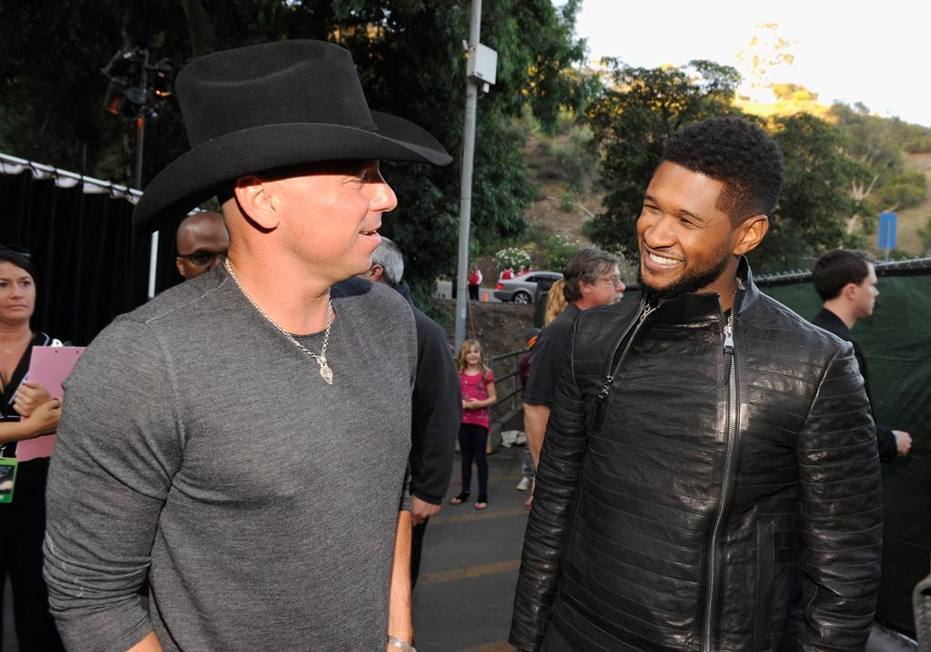 "Performers Kenny Chesney and Usher backstage at the ""A Decade of Difference"" concert on October 15, 2011, at the Hollywood Bowl, Los Angeles. <br><br>(Photo by Kevin Mazur/Getty Images for Control Room)"