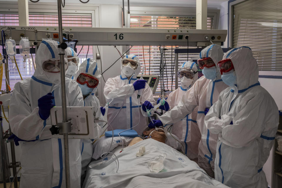 A patient infected with COVID-19 is treated in one of the intensive care units (ICU) at the Severo Ochoa hospital in Leganes, outskirts of Madrid, Spain, Friday, Oct. 9, 2020. Spain has become the first western Europe to accumulate more than 1 million confirmed infections as the country of 47 million inhabitants struggles to contain a resurgence of the coronavirus. (AP Photo/Bernat Armangue)